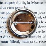 Badge vintage 32mm Dans l'Ombre