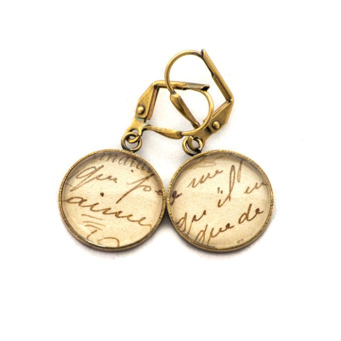 Boucles d'oreilles dorées carte postale Ecriture Aime